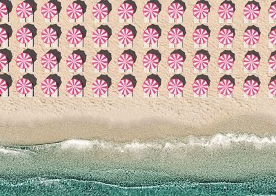 aerial top view on the beach with lots of beach umbrella. 3D rendering